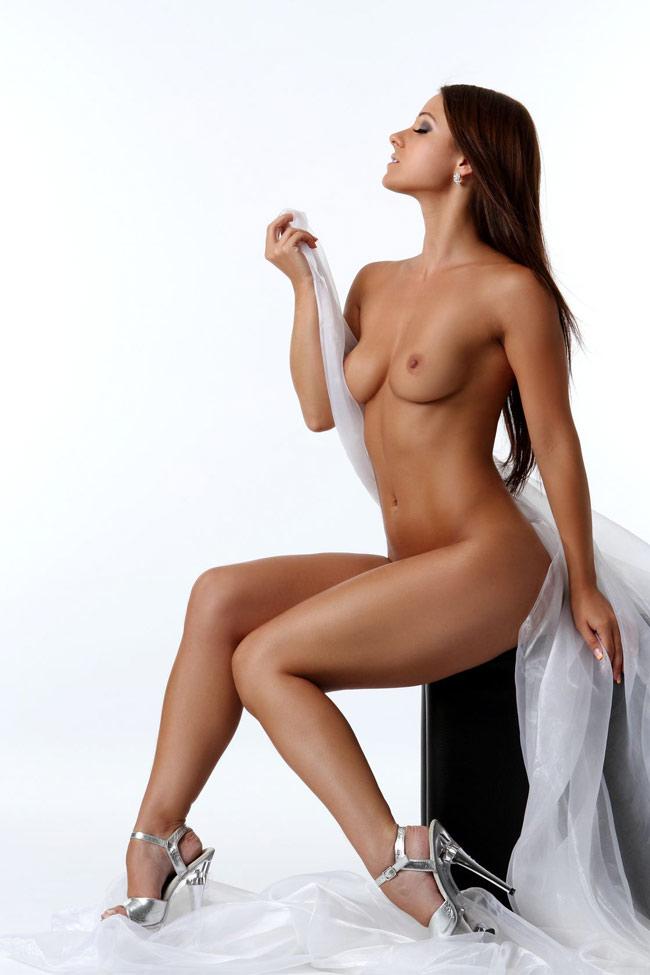 Beautiful erotic woman posing nude in heels